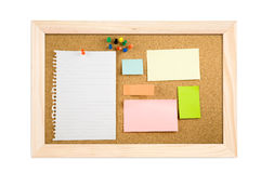 Corkboard with empty notes on maple wood. Corkboard with empty yellow, blue, pink, green, orange notes on maple wood background Royalty Free Stock Photo