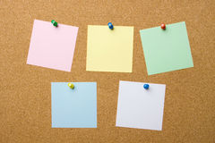 Corkboard with five blank notes Royalty Free Stock Image
