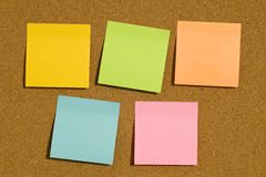 Corkboard With Five Blank Post-it Notes Stock Photography