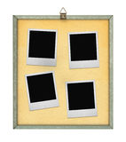 Corkboard with four photo frames stock photography