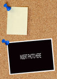 Corkboard with note and photo. Blank note and photo thumb tacked to corkboard Stock Photo