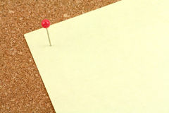 Corkboard and notepaper Royalty Free Stock Image