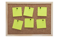 Corkboard with notes and pins Stock Photo