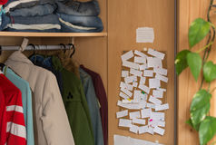 Corkboard with notes in wardrobe Royalty Free Stock Photos