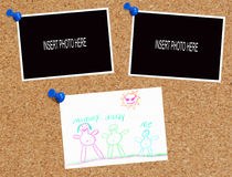 Corkboard with picture and photos. Cork board with blank photos and childs family drawing Stock Photo