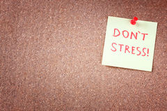 Corkboard with pinned yellow note and the phrase dont stress written on it. room for text. Stock Image