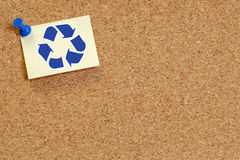 Corkboard with recycle symbol. On thumb tacked note Royalty Free Stock Photo