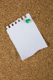 Corkboard with a sheet from a notebook Stock Photography