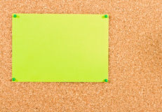Corkboard with sheet of paper. Stock Image