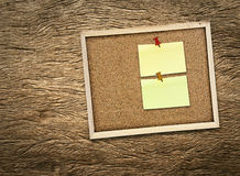Corkboard on wooden Royalty Free Stock Images