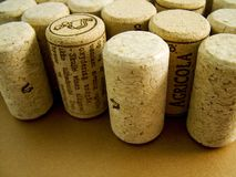 Corks. Collection of stood up on end on metallic bronze surface royalty free stock photo