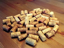 Corks. Several wine bottle corks on wooden surface Stock Image