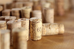 Corks arranged on wooden desk Royalty Free Stock Images