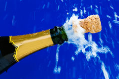 Corks and champagne bottle. Champagne bottle is opened. cork shooting out of the champagne bottle. symbolic photo for new year, new year's eve, parties and Royalty Free Stock Photos