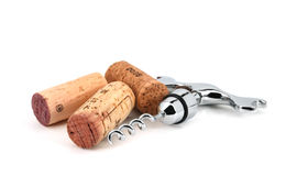 Corks and corkscrew. Close up of corks and a corkscrew isolated over white Royalty Free Stock Photo