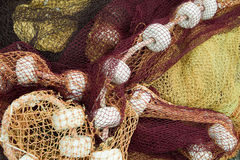 Corks and fishing nets. Colorful fishing nets in the port of Saint-Jean-de-Luz in Basque country in France royalty free stock photography