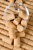 Corks in a glass wine. On background of new corks lined Royalty Free Stock Photography