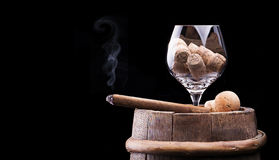 Corks In Cognac Glass And Cigar On Black Royalty Free Stock Photo
