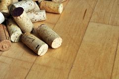 Corks on maple wood floor Stock Photos