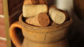 Corks in old pitcher Stock Images