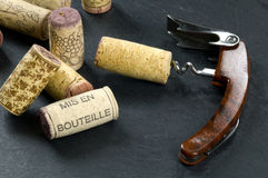 Corks and opener on slate Stock Photography