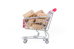 Corks in shopping cart. Wine shop conceptual image selling wine Stock Photos