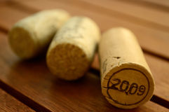 Corks. Three corks on a table made from wood Stock Images