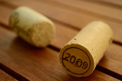 Corks. Two corks on a wooden table Stock Photography