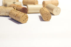Corks on white background. Closeup studio shot of multiple wine corks scattered on a plain background with copy space. Selective focus used. Horizontal Royalty Free Stock Images