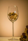 Corks in wine glass Royalty Free Stock Images