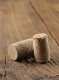 Corks on a wooden table, close up Royalty Free Stock Photography