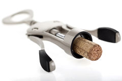 Corkscrew. Mechanic corkscrew on white plastic Royalty Free Stock Photography
