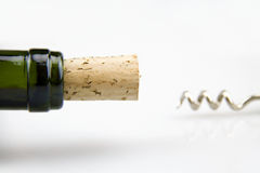 Corkscrew. Unscrewing a bottle of wine Stock Images