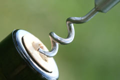 Corkscrew. Close up of corkscrew and wine bootle Stock Photos