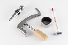 Corkscrew and accessories for wine. Isolated royalty free stock image