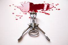 Corkscrew in a blood pool. On a white background Stock Photography