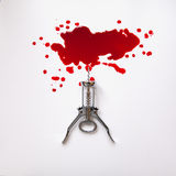 Corkscrew in a blood pool. On a white background Royalty Free Stock Photo