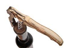Corkscrew and bottle Stock Photo