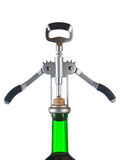 Corkscrew and bottle of wine Royalty Free Stock Photography