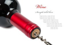 Corkscrew with a bottle of wine. Opening bottle of red wine royalty free stock photos