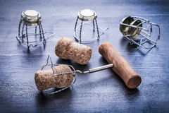 Corkscrew and corcks of champagne wirh wires Stock Photo