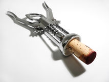 Corkscrew with cork. Red from the wine Royalty Free Stock Images