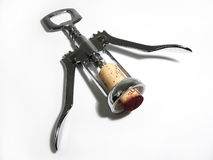 Corkscrew with cork. Corkscrew with freshly used cork, still red from the wine Stock Photo