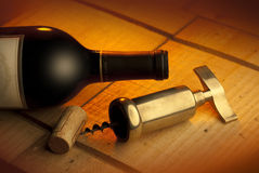 Corkscrew,cork and bottle. A corkscrew,cork and bottle of wine shot on wood crate Stock Images