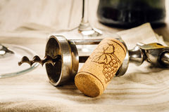 Corkscrew, cork and glasses. Corkscrew, cork, wine glasses on the table Royalty Free Stock Photo