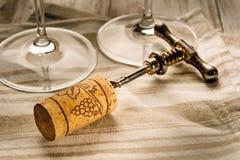 Corkscrew, cork and glasses. Corkscrew, cork, wine glasses on the table Stock Image