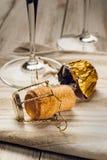 Corkscrew, cork and glasses. Corkscrew, cork, wine glasses on the table Stock Photos