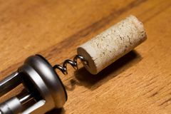 Corkscrew with a cork Stock Photos