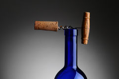 Corkscrew and Cork on Top of Wine Bottle Royalty Free Stock Photography