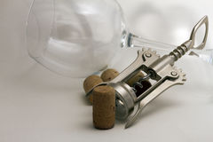 Corkscrew, cork and wine glass Royalty Free Stock Images